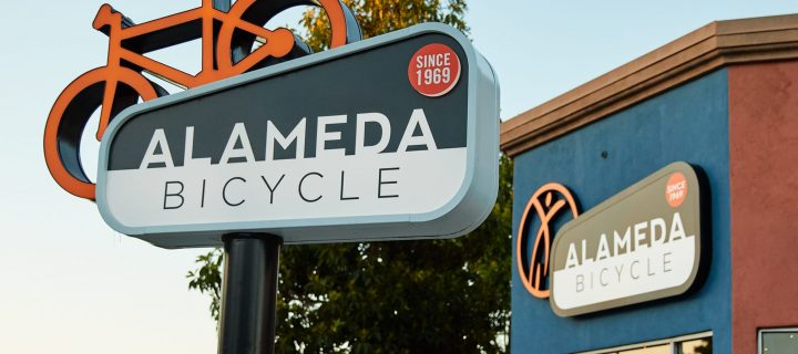 Ad Art Sign Co., AdArt, Full Service Signage, LED Lighting, Digital Signage,Retail, Face-lit double faced bike element on face it, with routed out and push-thru year indicator, pole sign, Alameda, CA,